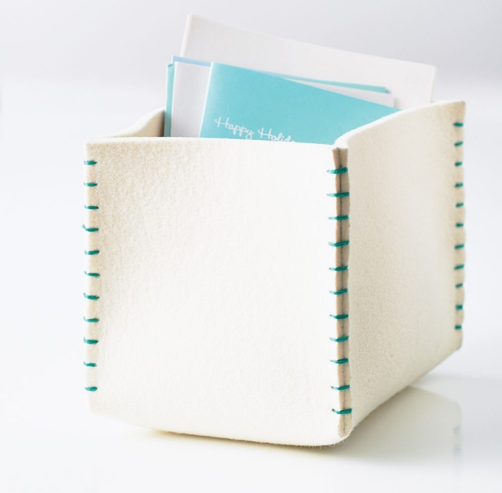 Felt organizer: Heavy felt is thick and weighty enough to hold its shape as an organization box. Because felt is made from pressed fibers that won't unravel, you won't need to line the inside or finish the edges.