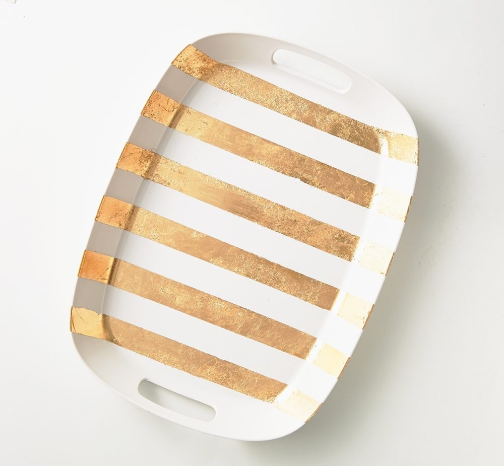 Metallic-striped tray: Stripes of gold leaf create the lines on this decorative tray. Once sealed, this tray is ready for service.
