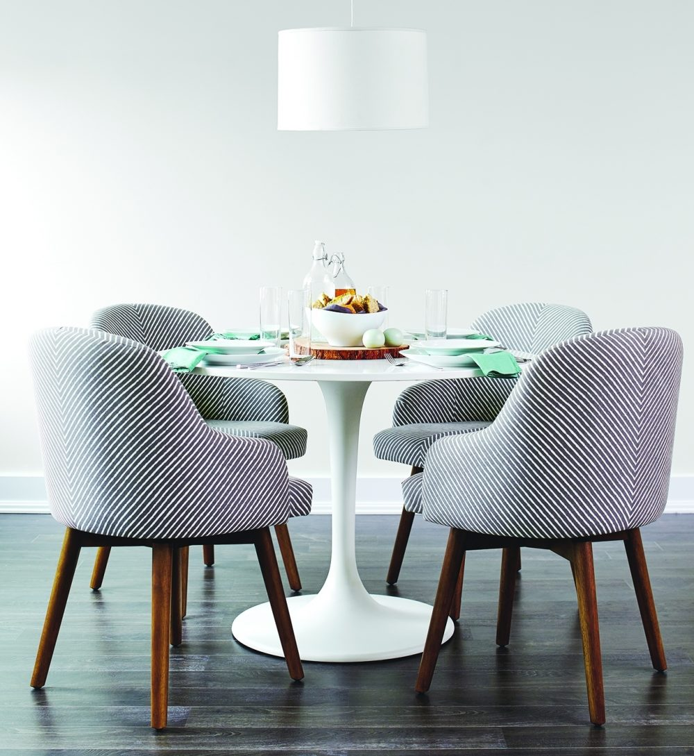 Family dinner should be a relaxed affair. Creating the right setting helps. Chairs with arms and cushioning are more comfortable than solid wood or metal chairs, so they encourage family members to linger.