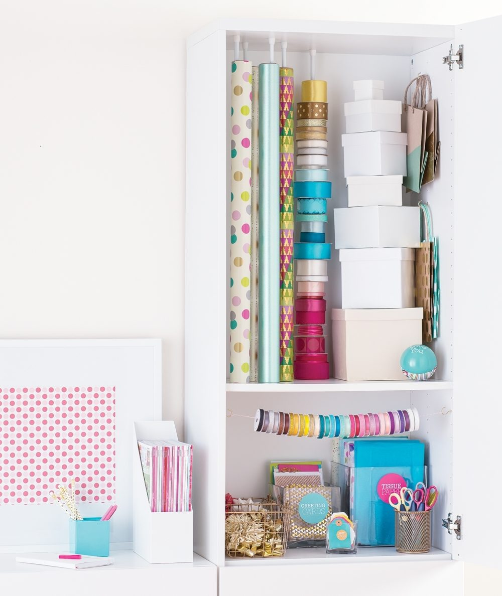 Tension rods, hooks, shelves, organizers and containers all have their place in a gift-wrapping cupboard. Keep everything visible by placing shorter items in the front. USe untapped vertical space to maximize storage capacity.