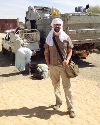 Here I am with my camera bag slung over my shoulder about to climb aboard a truck headed deep into the desert in Chad. As a photographer for Horizons Magazine, I was headed out to capture images of missionaries delivering supplies for a new school building. There was no room in the cab, so I rode in back, jostled on top of the supplies. Now I know how practical turbans are in the sun-scorched desert.