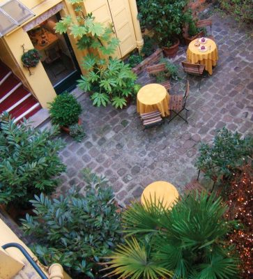 The courtyard is one of the features of the Hotel de la Tulipe, a small family-run hotel in Paris's 7th arrondissement.