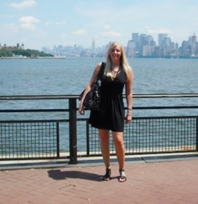 L:B Associated Art Director Britney Peterson poses on the waterfront in New York City.