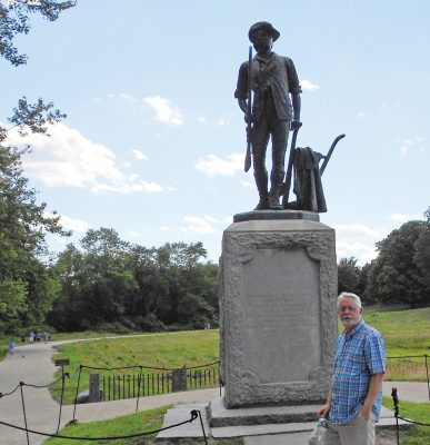 Author Steve Cooper pays his respects to Revolutionary soldiers at the Minute Man statue in Concord.