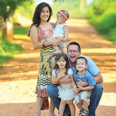 Aby and Stephen Nelms pose for a family portrait with their three children in Zambia, where they do mission work.