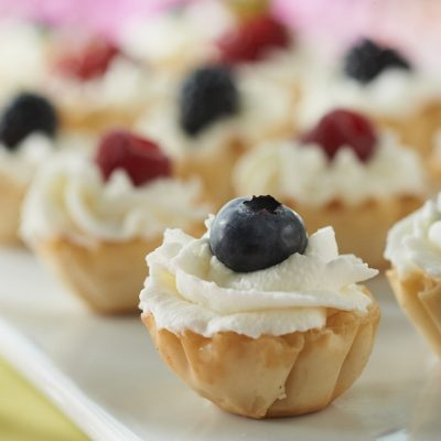 Make miniature tarts filled with a mix of yogurt, whipped topping and heavy whipping cream. With prepared phyllo shells, there's no baking.