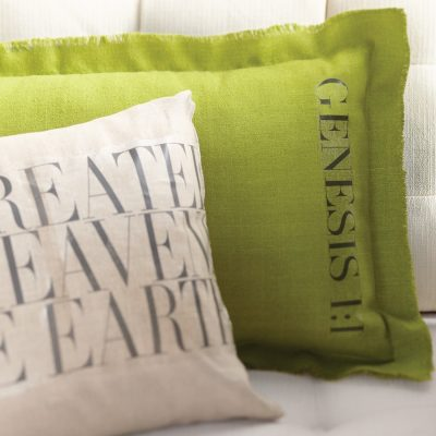 A graphic Bible verse on crisp linen pillows is created with heat transfer paper.