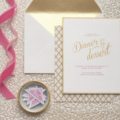 Delight your guests with an invitation that lives up to the evening to come. A clean border of gold ink and a geometric pattern on the reverse side announce your party will be one not to miss.