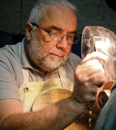 An artisan works at the House of Waterford Crystal in Ireland.