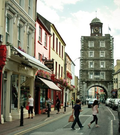 Neat European rows of historic buildings line this street in Youghal, Ireland.