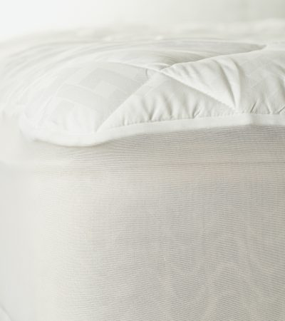 The mattress pad provides protection for your mattress from stains, such as perspiration, and because it can be washed, it keeps your bed fresher than sleeping directly on a sheet-covered mattress.