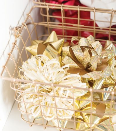 For easy organization, remove wrapping materials from their original packaging and place them in storage containers. Divide items by color or size to efficiently organize and access.