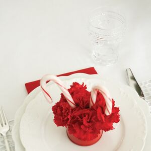 A white and red Christmas table setting