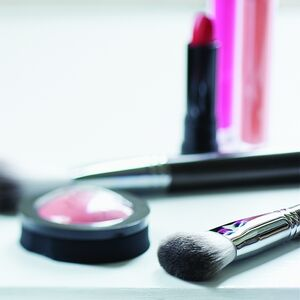 Cosmetics sit on a table.