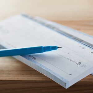 a pen sits on a checkbook