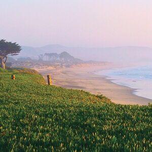 Dusk settles on a stretch of beach.
