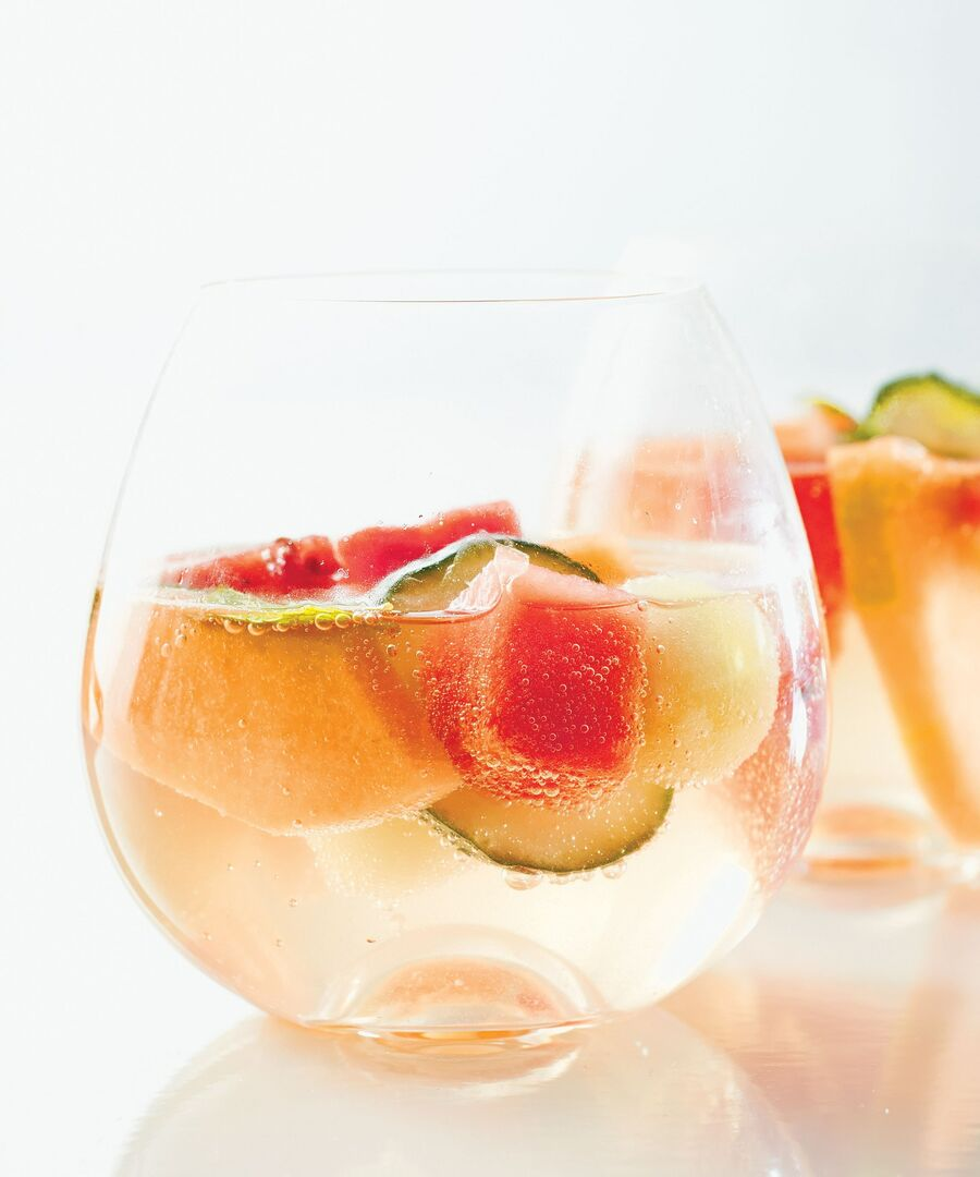 Piece of cut melon inside a glass of sparkling water