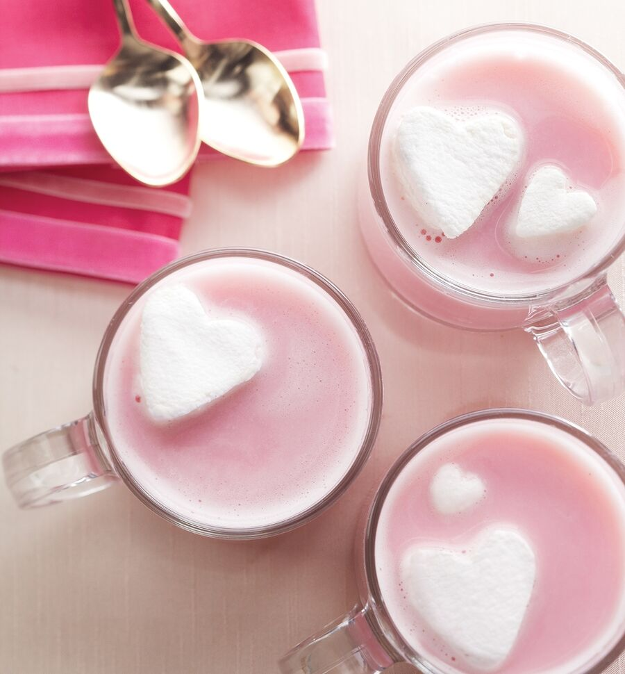 Cap off the evening with mugs of hot (pink!) chocolate. Melted strawberry sherbet and milk form the bas of the drink and melted white chocolate adds richness and body. Use cookie cutters to shape marshmallows into floating hearts that beg to be nibbled.