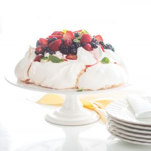 Named after Russian ballerina Anna Pavlova, this dessert is as elegant as a pirouette yet easy to make. Topping our version, Berry Lemon Pavlova, is a pillow of whipped mascarpone cream, berries and mint.