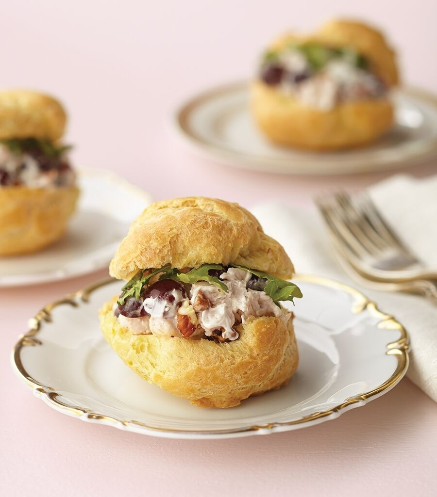 Chicken salad with pecans and grapes is served in cream puff bowls