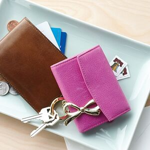 Wallets, keys, and change are collected on a catch-all plate