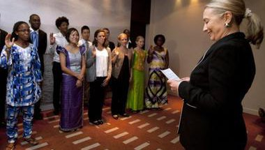 Secretary of State Hilary Clinton swears in group of Peace Corps Volunteers