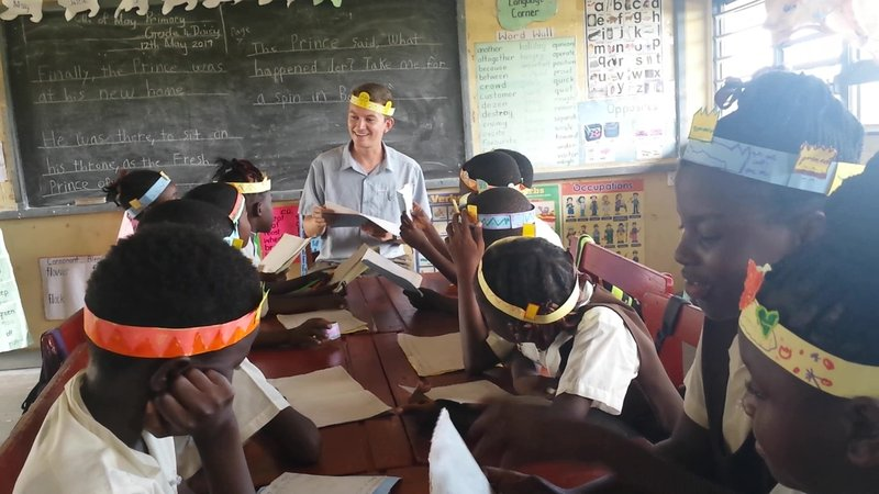 """Doing a reading of """"The Prince"""" after the class crafted crowns and started illustrating individual books to take home."""