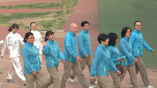 Lawrence Kahn marches in a Sports Day celebration with members of the English department at his university site in Lanzhou.