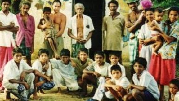Peace Corps Volunteer with Villagers