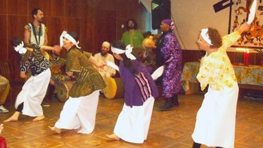 Performing african dance at Kwanzaa celebration