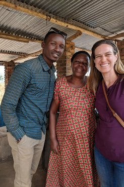 Kait standing with two people from the Shining Coffee company in Rwanda