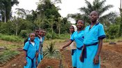 Students standing in their garden after finishing their work