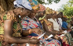 a group of women reviewing a document