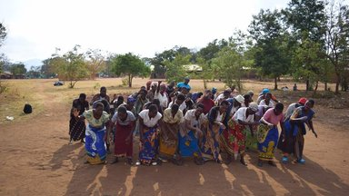 Choir group rehearsing and dancing