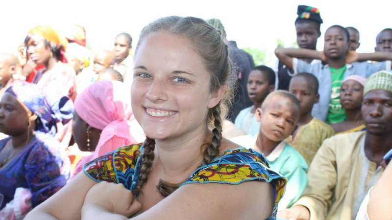 A Peace Corps Volunteer watches a celebration in her community in Cameroon.