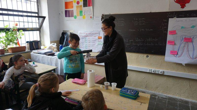 Minju delivers an oral health hygiene lesson to 4th grade class in Albania.