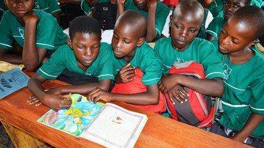 Pupils read a book on DEAR Day.JPG