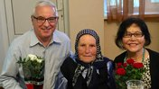 Older American man celebrates birthday with Moldovan grandmother and wife