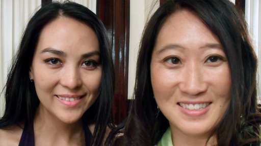 Two women smile side by side for an up-close selfie