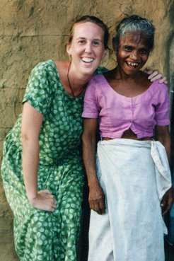 Pcv posing with a smiling village lady