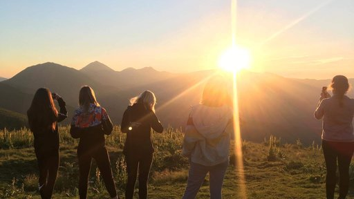 Campers enjoy the sunset on their first night of GLOW