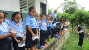 School children brushing their teeth