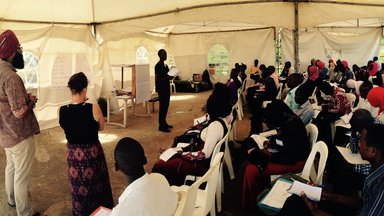 Peace Corps Volunteers facilitating a business plan session.jpg