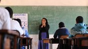 Fiorella at the front of the classroom teaching a lesson on English