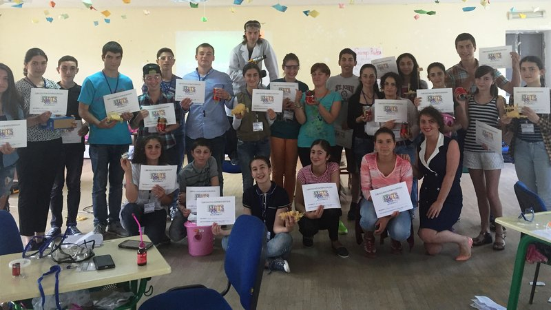 Students holdig METS certificates