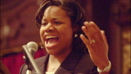 A close up picture of a young, Black woman speaking.