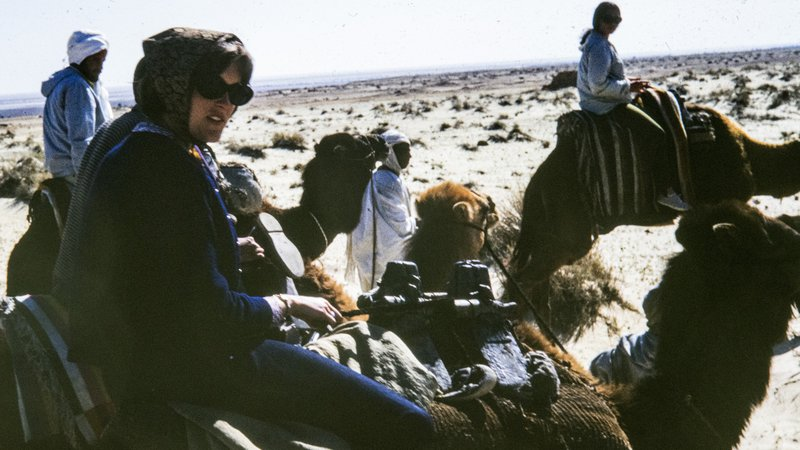 Director Olsen rides a camel while serving as a Peace Corps Volunteer in Tunisia.