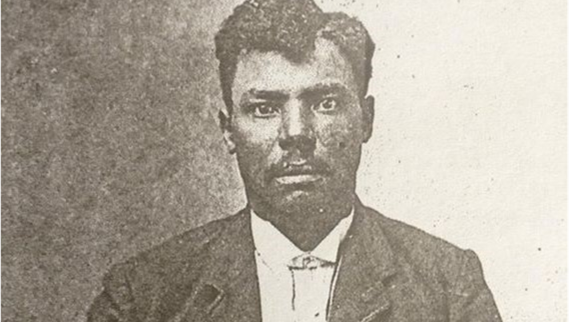 Old black and white portrait photo of a black male