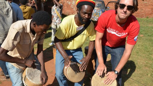 Joe drums with two Malawian friends at Malawi Music Project camp.