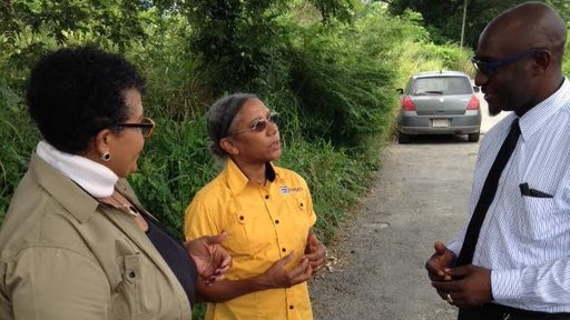 Mickie meeting with her counterpart and school principal on the road in Jamaica (2016-17)